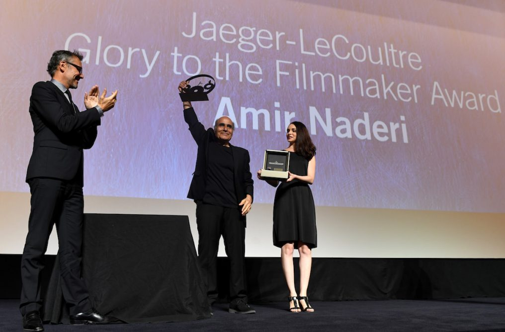 VENICE, ITALY - SEPTEMBER 05: Jaeger LeCoultre Communications Director Laurent Vinay (L) presents director Amir Naderi the Jaeger Le Coultre Glory To The Filmmaker Award on stage at the 'Jaeger-LeCoultre Glory To The Filmmaker 2016 Award' Honors Amir Naderi Award Ceremony during the 73rd Venice Film Festival at Hotel Excelsior on September 5, 2016 in Venice, Italy. (Photo by Ian Gavan/Getty Images for Jaeger-LeCoultre) *** Local Caption *** Amir Naderi; Laurent Vinay
